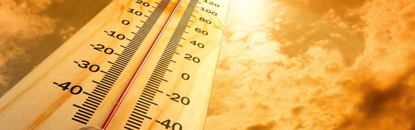 Thermometer places against a hot sky