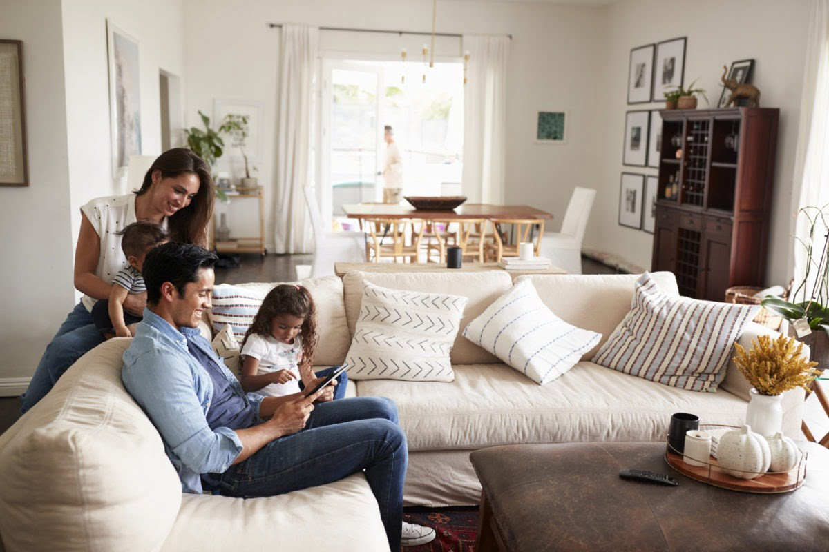 Young Hispanic family spending time in their living room