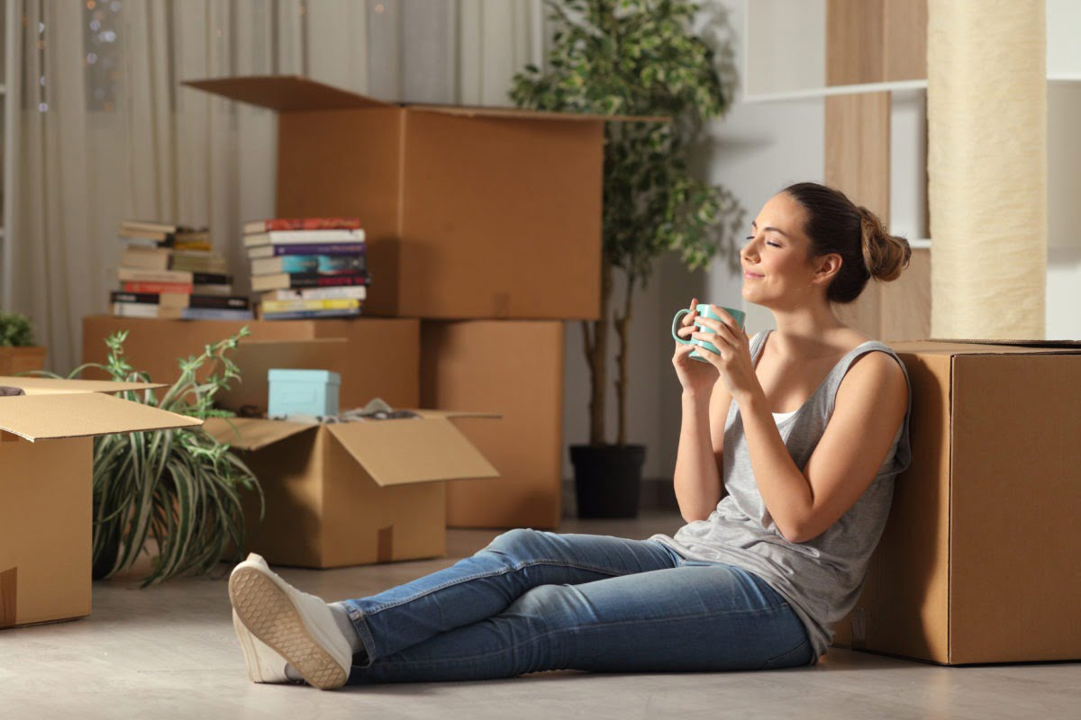 Happy tenant moving into her rental home